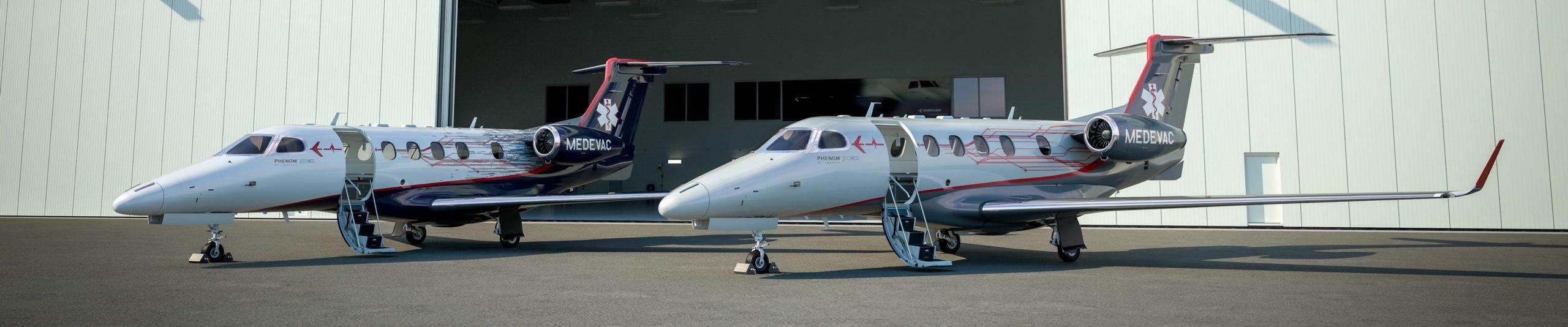 Deux Embraer Phenomm 300MED au hangar